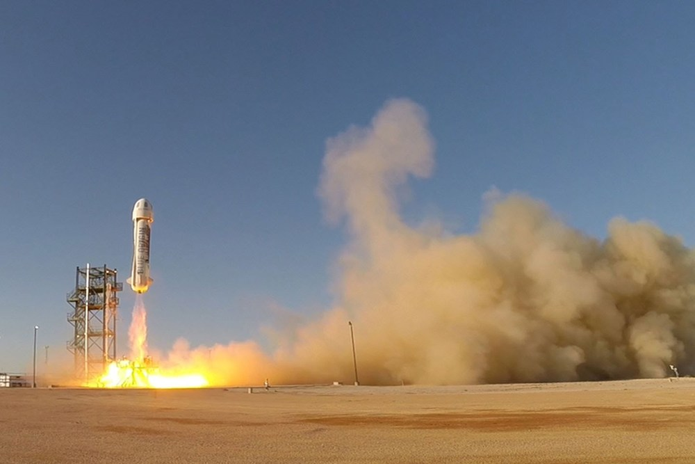 The New Shepard space vehicle blasts off on its first developmental test flight over Blue Origin's West Texas Launch Site. The crew capsule reached apogee at 307,000 feet before beginning its descent back to Earth  . Photo credit: Blue Origin