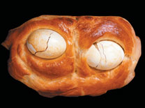 "Ojos de Haman , or Eyes of Haman,  is a Kosher bread with two hardboiled eggs baked into the loaf to represent Haman's eyes. The ""eyes"" are torn out of the bread, much like Haman's were torn out of his head."