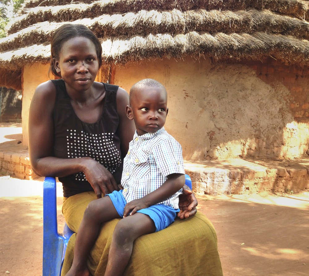 """Meet Florence. """"...that day could have been the end of my life if not for NUMEM to bring an ambulance which took me up to the hospital – everyone else had given up and they were waiting for me to die."""" - Alimocan Florence, northern Uganda  On April 13, 2015, Florence gave birth to her son at a governmental district Health Centre III. After her delivery, she started to hemorrhage; Florence collapsed and became unconscious. Because of NUMEM's emergency call box system, medical personnel was able to arrange for emergency transport to the nearest hospital, over 60km away. It was with funds and donations supplied to NUMEM that the emergency call box system exists. Help support healthcare initiatives like this!"""
