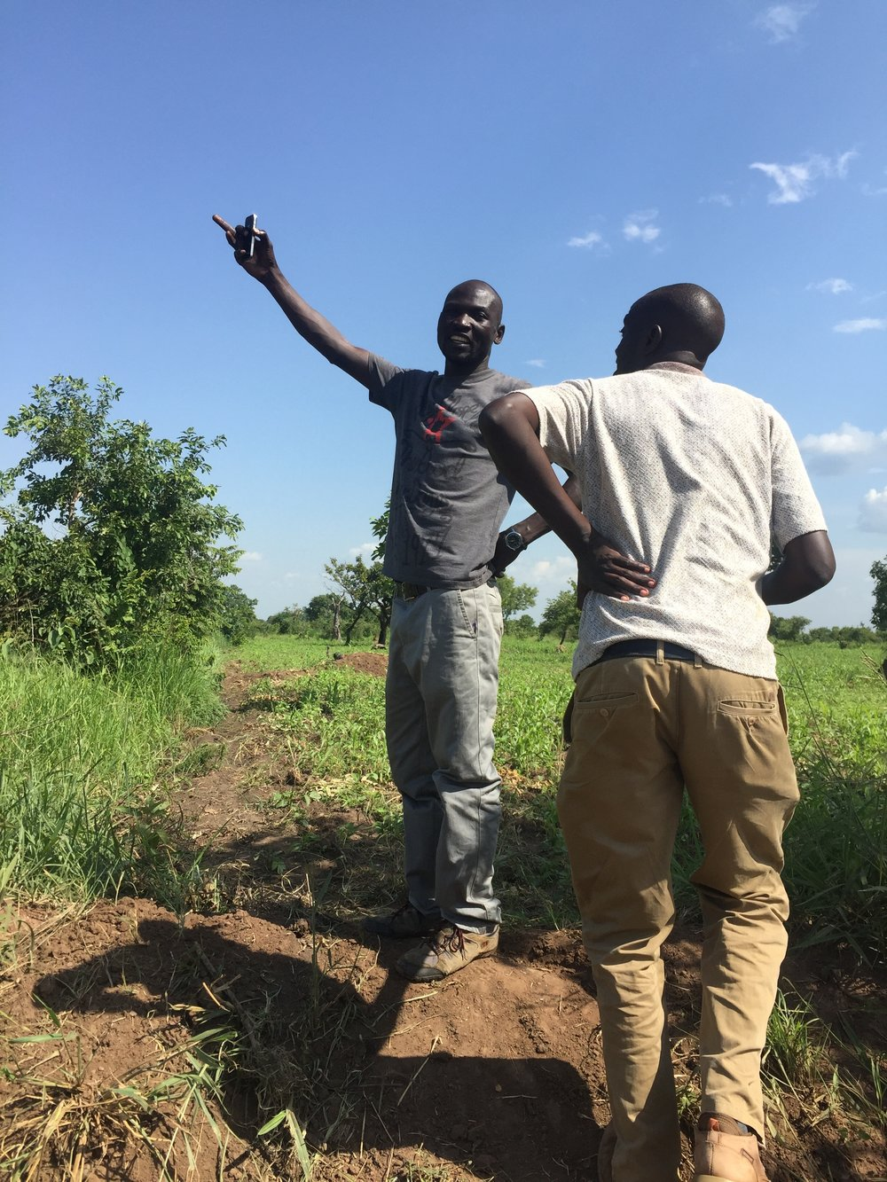 NUMEM Clinic co-founders, Olanya Denish and Atiya Patrick Kasagara showing Asteroidea the land purchased for the future hospital, the first of its kind in Pader District.