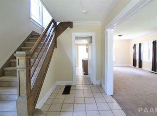 1608 Fredonia-foyer-stairs-living room.jpg
