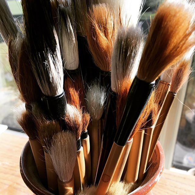 Glazing brushes in the sun.