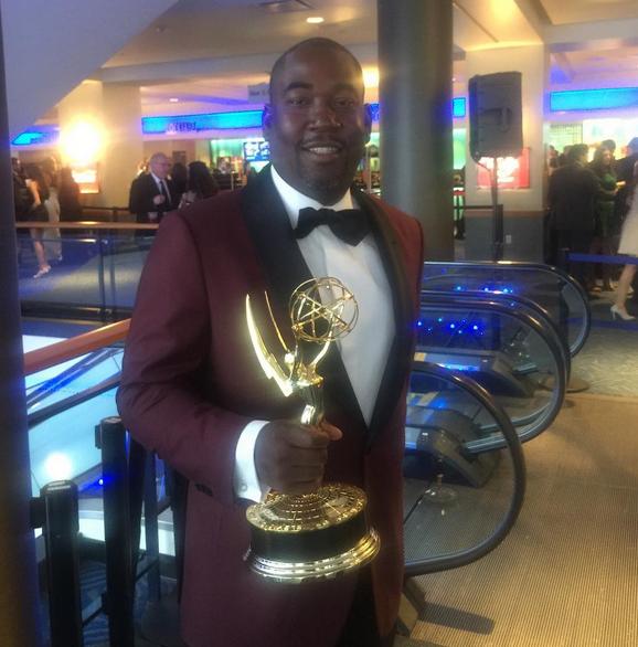 Shakim holding the Emmy