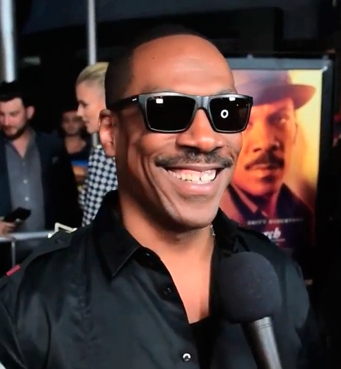 Eddie Murphy smiling for the cameras