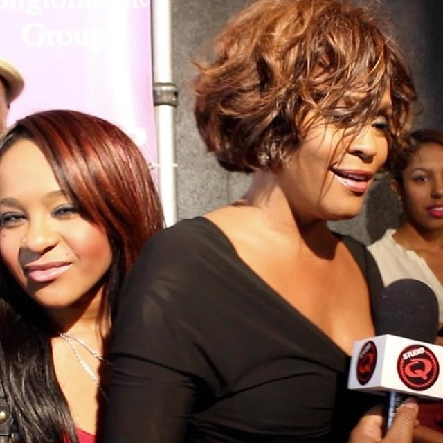 Whitney and Bobbi Kristina on the red carpet and me holding my Studio Q Mic