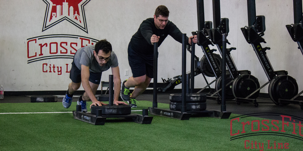 Cyril and Nikolaos dig deep to start another round of sled pushes