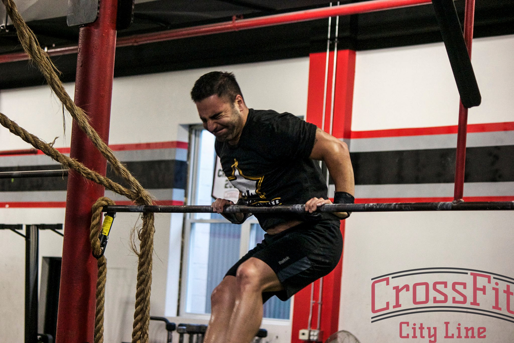 Arda fights to complete another bar muscle up