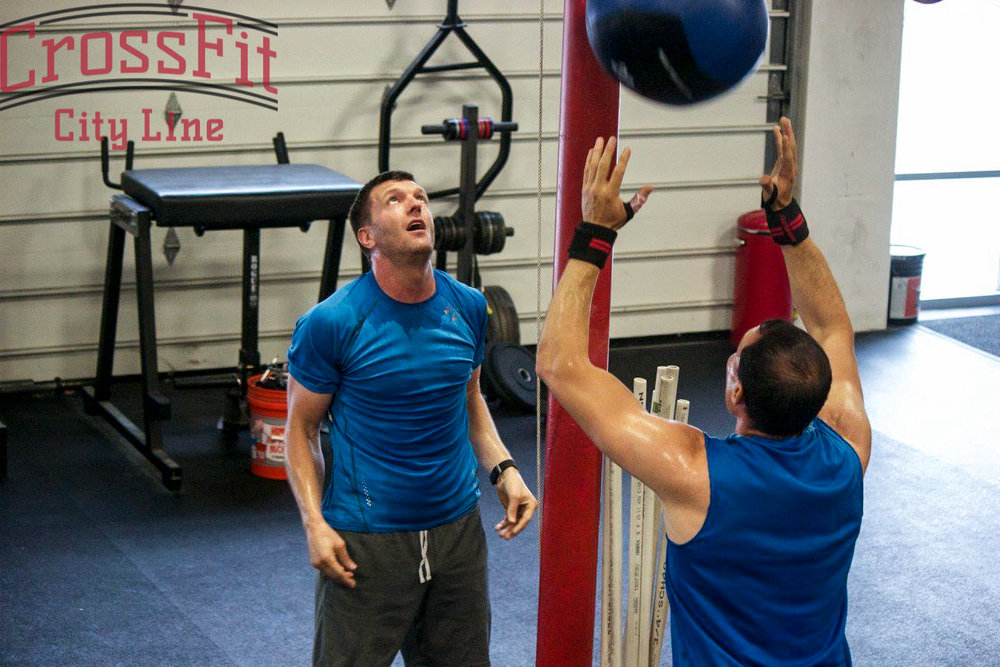 Shaking out your arms during wallballs can be an effective way to avoid fatiguing your shoulders.