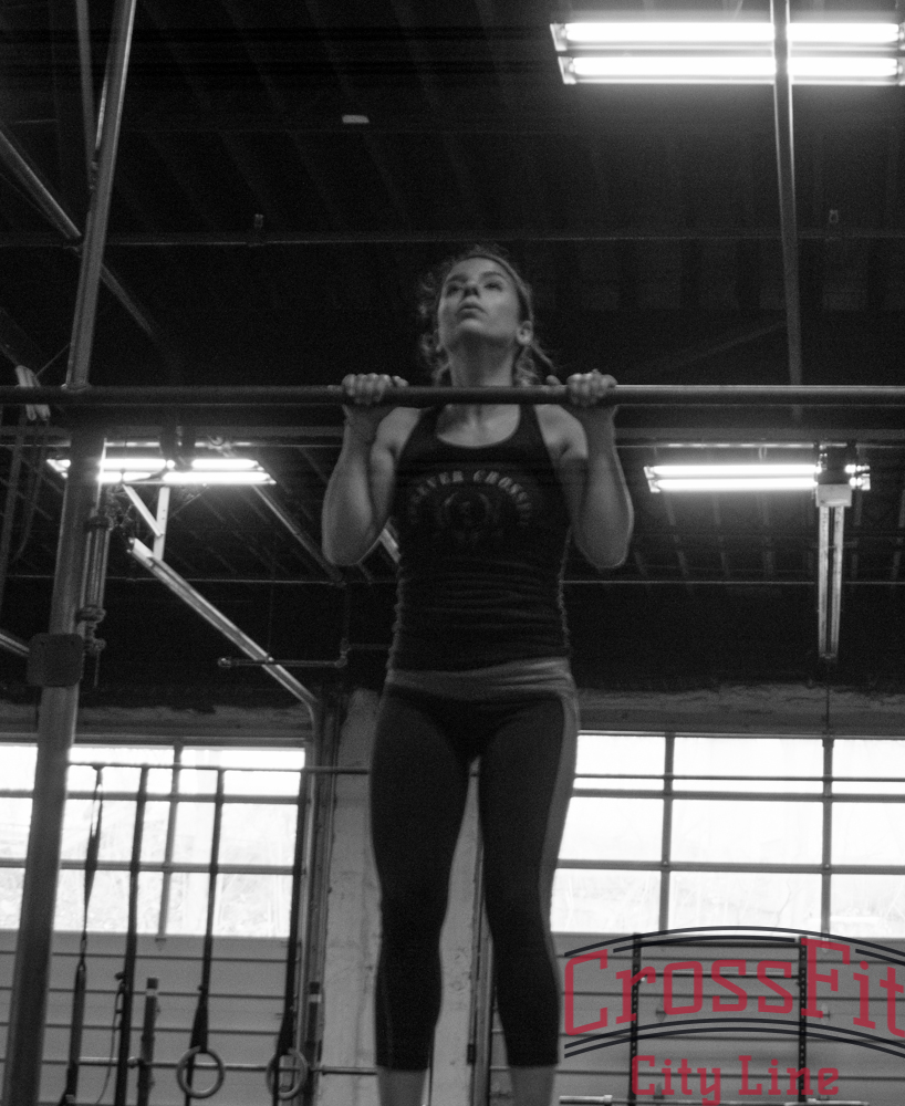 Tanya knocking out one of many burpee pull-ups during GI Jane