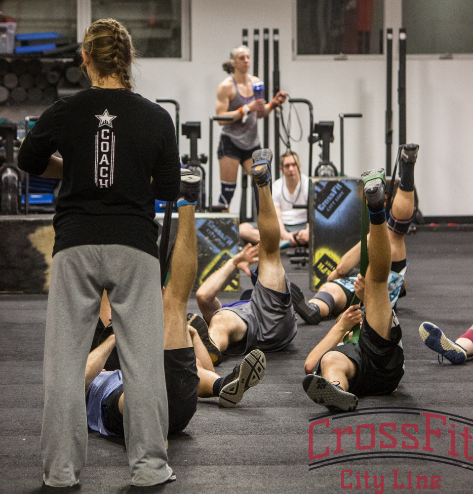 Coach Cassi leading her class through some crucial post-WOD stretching