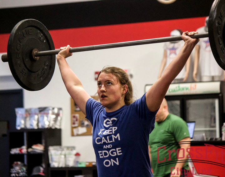 Alli stays focused during her overhead squats