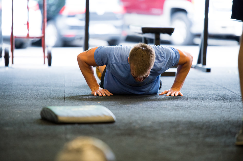 """The push-up is more a family of movements than a single exercise. In fact, it is a progression that starts from the horizontal, which is the classic ""P.E. push-up"" and then, through gradually, incrementally, elevating the feet from the floor to a point where the athlete is eventually in a handstand, becomes the handstand push-up."" - Greg Glassman, The Push-Up"