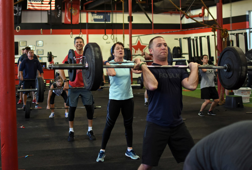 Want to improve your front rack position?  Check out these tips from The Barbell Physio.
