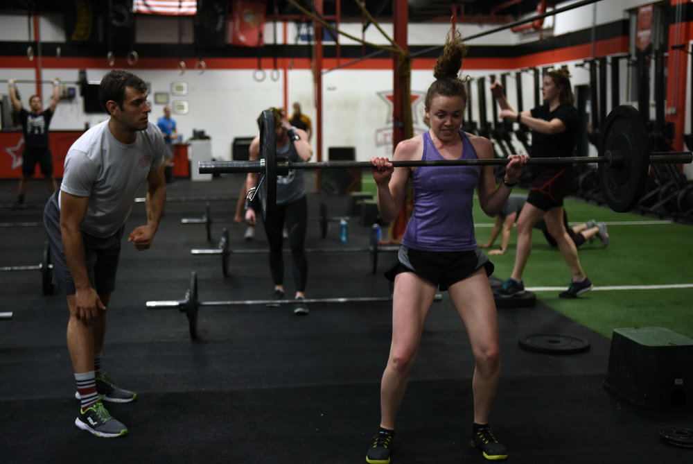 Rachel shows Coach Mat her power clean.