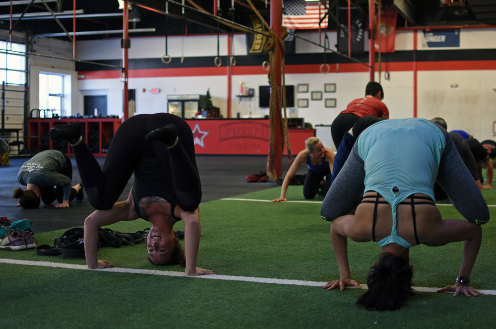Mel and Anushka execute beautiful tripod positions in a headstand.