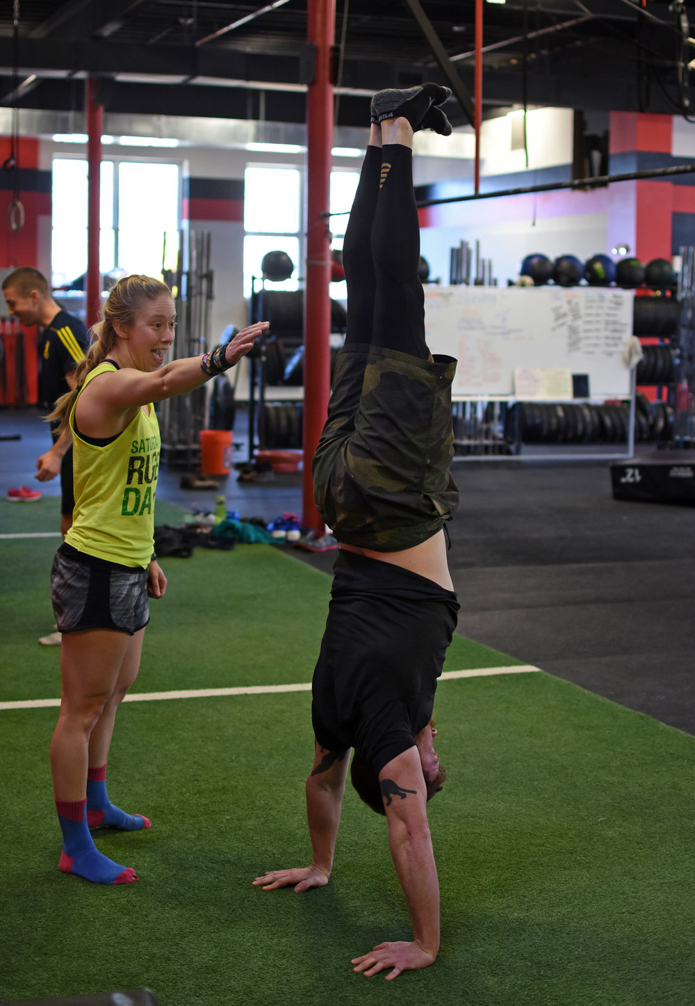 A well-executed handstand begins with excellent shoulder and thoracic mobility and midline stability.