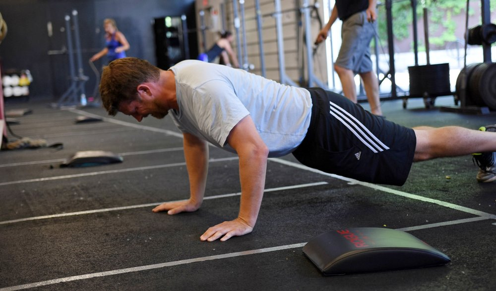 Bryan--A perfect push-up is defined by a solid midline. The torso remains rigid as the arms bend and straighten again.
