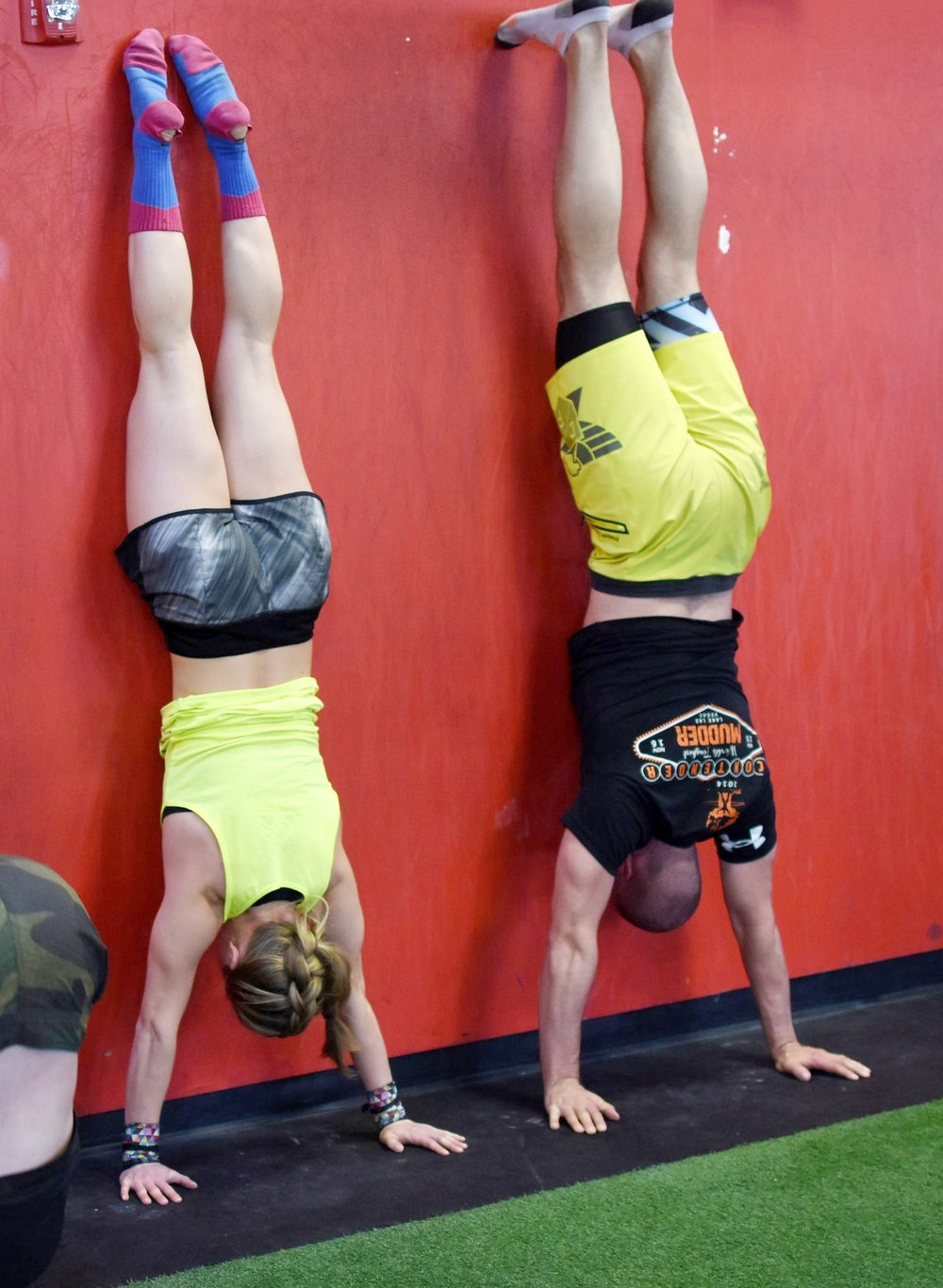 The Wall Climb is a shoulder and midline stability builder. Maintaining control from the bottom to the top and back again to the bottom is key. To do this, keep the glutes squeezed and hold a hollow position, keeping the belly away from the wall.