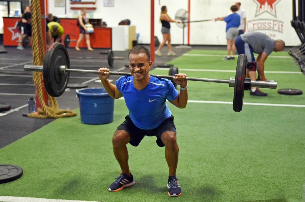 Be like Franklyn--smile while you back squat!
