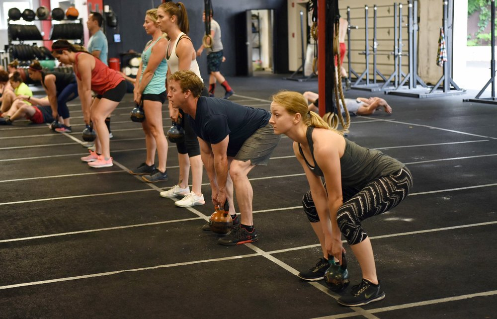 The crew gets warmed up for Kettlebell Swings.