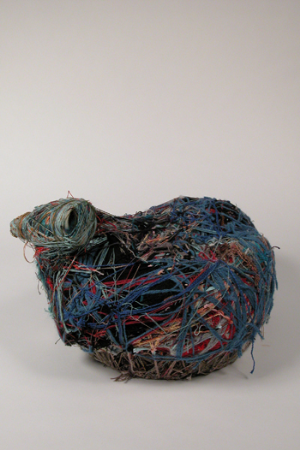Judith Scott (American, b. 1943), Untitled (Blue Bird Pod), n.d., Mixed fibers on found objects, 13 in. x 20 in. x 17 in. Collection of Intuit: the Center for Outsider and Intuitive Art, Gift of Creative Growth Art Center, 2004.6.4