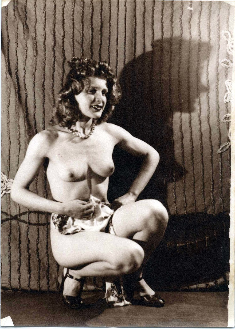 Eugene Von Bruenchenhein (American, 1910-1983).  Untitled (Marie crouched, chenille bedspread background, shadow) , n.d. Gelatin silver print, 7 x 5 in. Intuit: The Center for Intuitive and Outsider Art, gift of Lewis and Jean Greenblatt, 2005.4.14
