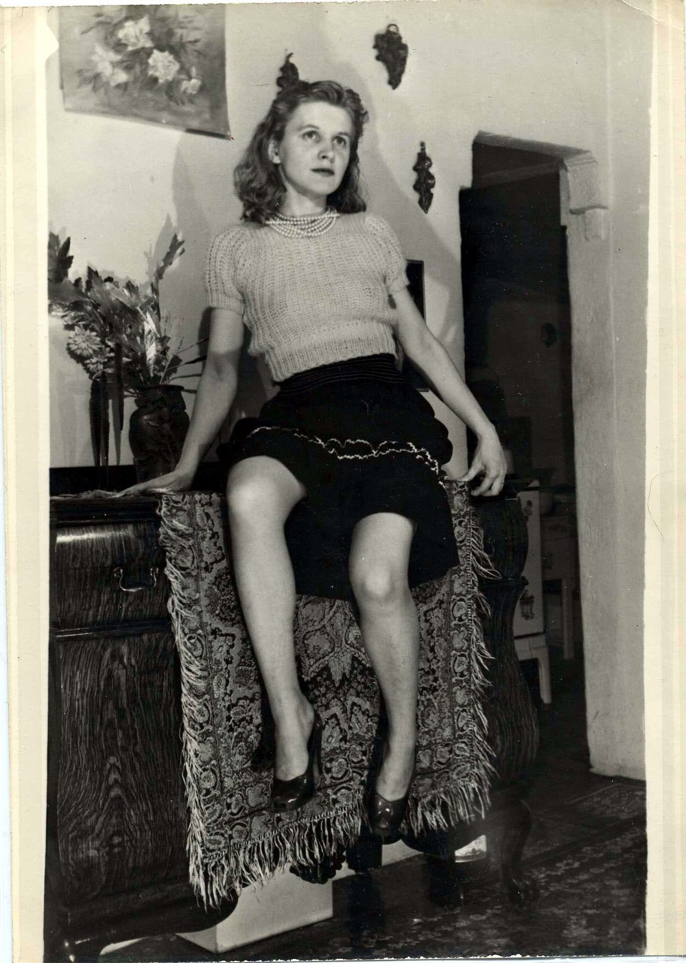 1.         Eugene Von Bruenchenhein (American, 1910-1983).  Untitled (Marie perched on table, interior view of home) , n.d. Gelatin silver print, 7 x 5 in. Intuit: The Center for Intuitive and Outsider Art, gift of Lewis and Jean Greenblatt, 2005.4.11