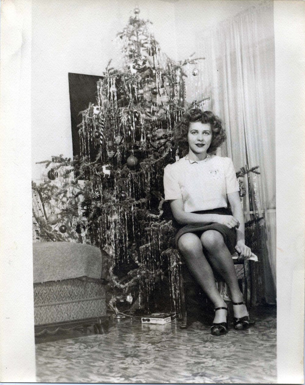 Eugene Von Bruenchenhein (American, 1910-1983).  Untitled (Marie seated by decorated Christmas tree) , n.d. Gelatin silver print, 10 x 8 in. Intuit: The Center for Intuitive and Outsider Art, gift of Lewis and Jean Greenblatt, 2005.4.4