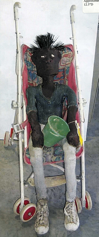 Dr. Charles Smith (American, b. 1940).  Bay Bay Kid , ca. 1995-2002. Concrete, mixed media, and paint, 37 x 14 x 12 ½ in. Intuit: The Center for Intuitive and Outsider Art, gift of Kohler Foundation, Inc., 2004.2.3