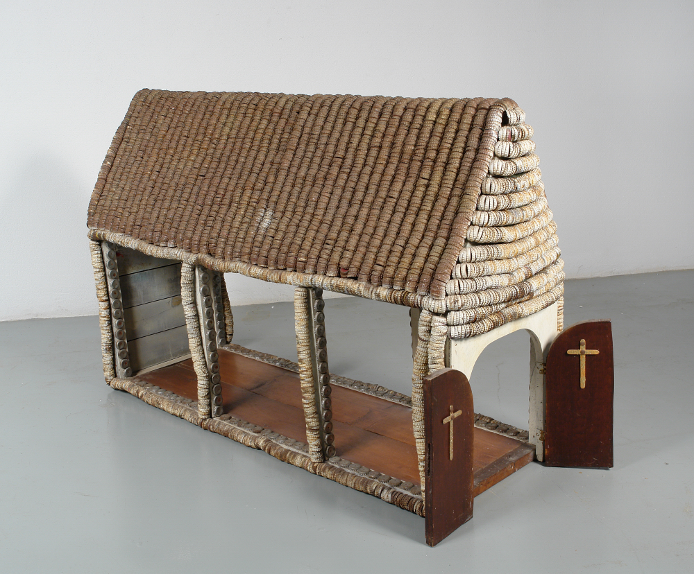 Clarence Woolsey (American, 1929 -1987) and Grace Woolsey (American, 1921-1992).  Bottle Cap Chapel , n.d. Wood and bottle caps, 33 x 50 x 17 in. Intuit: The Center for Intuitive and Outsider Art, gift of Marjorie and Harvey Freed, 2007.14