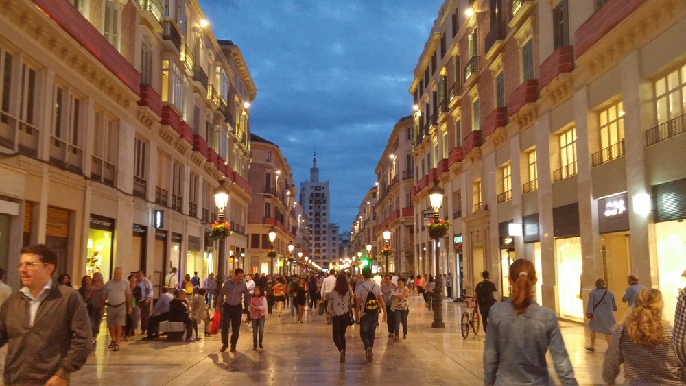 During the day and all throughout the night, the central calle, Larios, is packed with people.