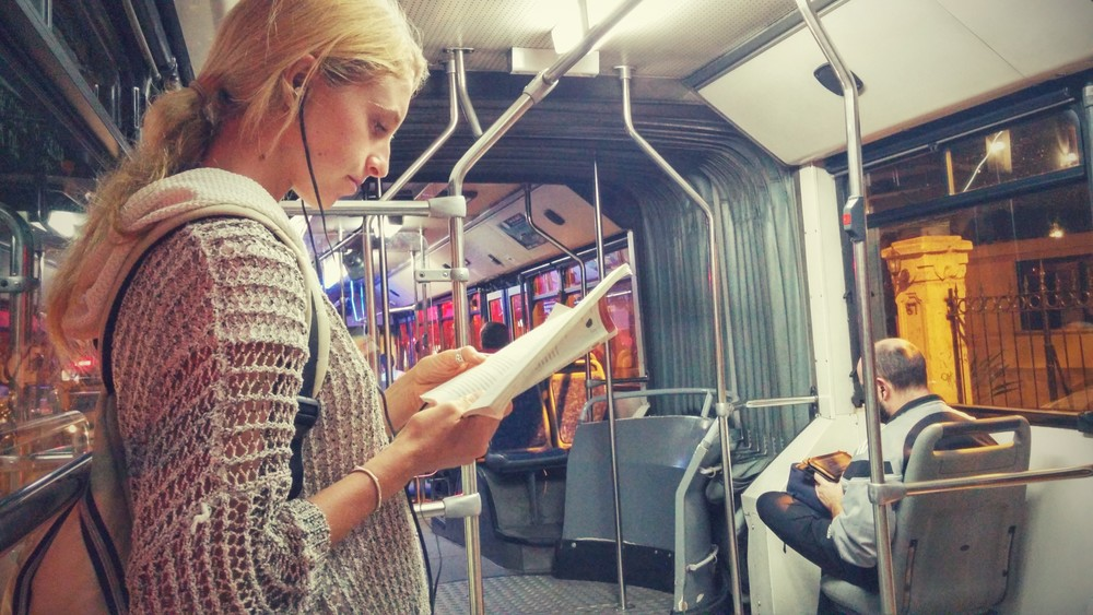 Many people sit quietly, listen to music at a normal volume, or read on the bus.