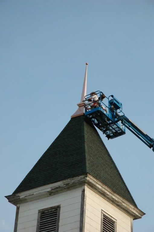 Installation of refurbished spire on the Bell Tower.