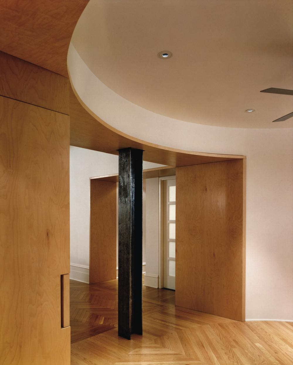 Modern Apartment Renovation | Upper East Side Manhattan New York City | Foyer Exposed Steel Column Curved Wood Portal Opening Wood Flooring | RES4