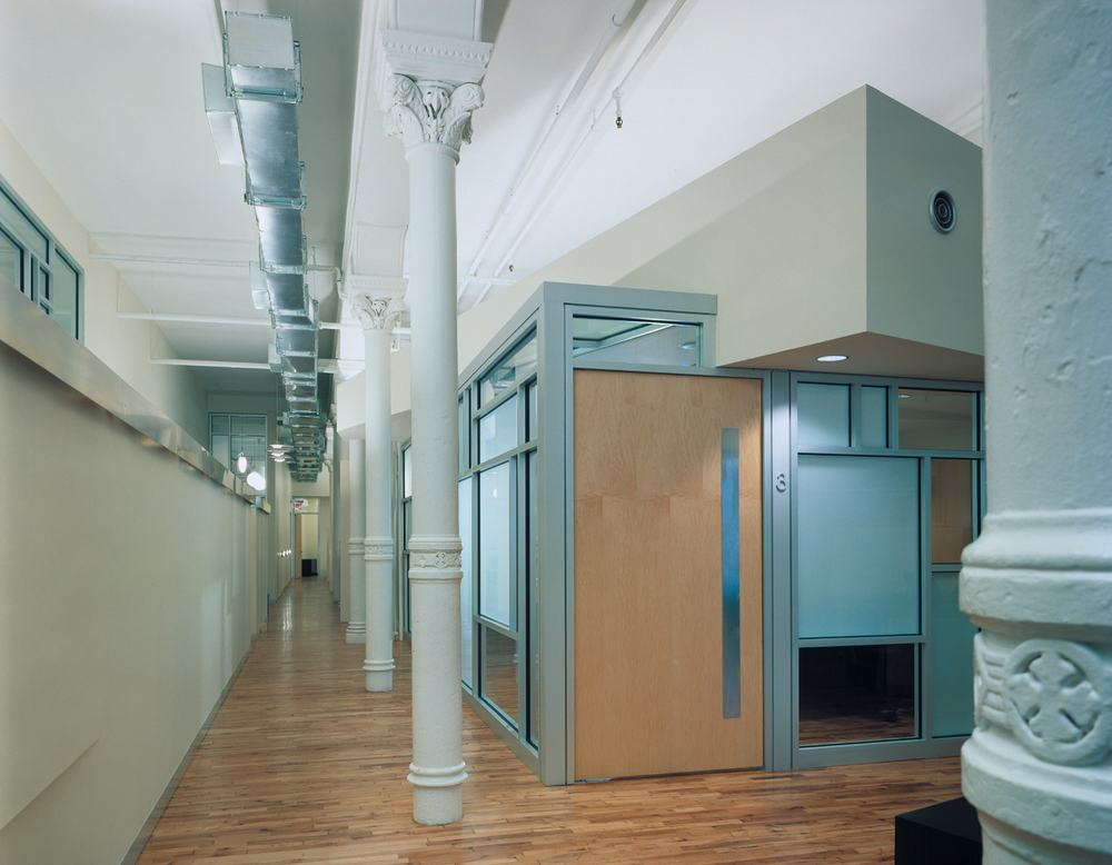 Equinox Offices Headquarters Modern Heath Fitness Center Renovation | Manhattan New York | Exposed Column Structure Storefront Office Wood Door | RES4