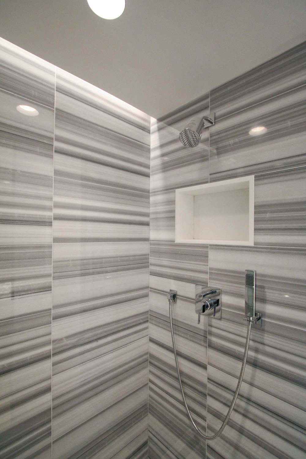 "Powder Room  (with secret shower hidden behind a sliding panel) -  ""Zebra"" tile"