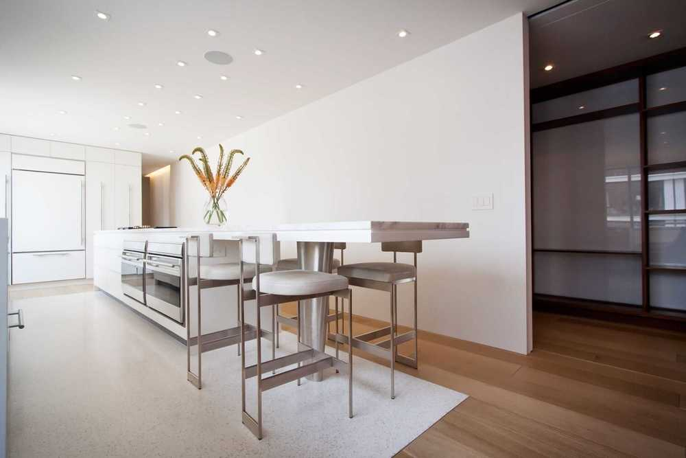 Modern Apartment Renovation | East End Ave New York City | Kitchen White Custom Cabinets Stone Countertop Stools | RES4