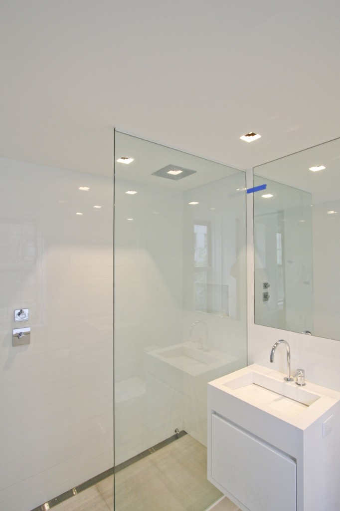 Bathroom  -  Glass partition to prevent splashing for the shower and floating vanity to complement the modern aesthetic.