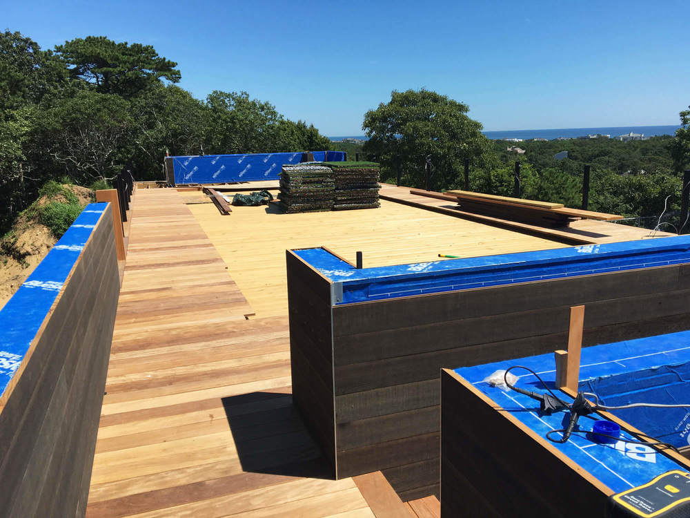 Roof Deck  -  Ipe decking and bocce court installation are in construction.