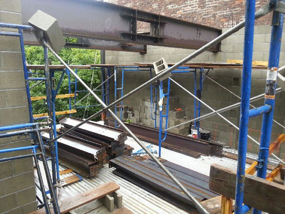 Steel beams laid out and ready for assemblage