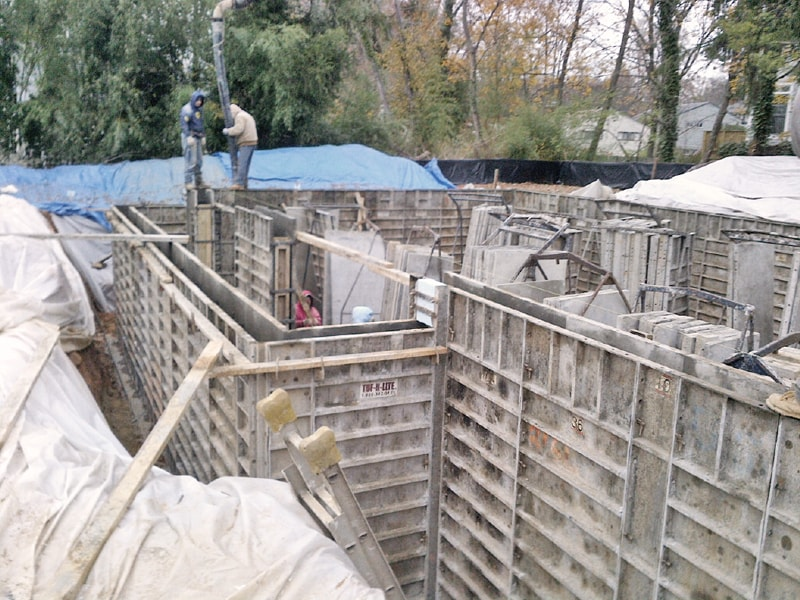 Workers constructing the formwork for the houses foundation