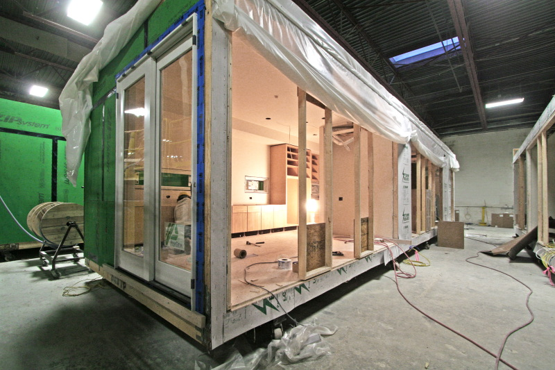 Interior cabinetry being assembled within module