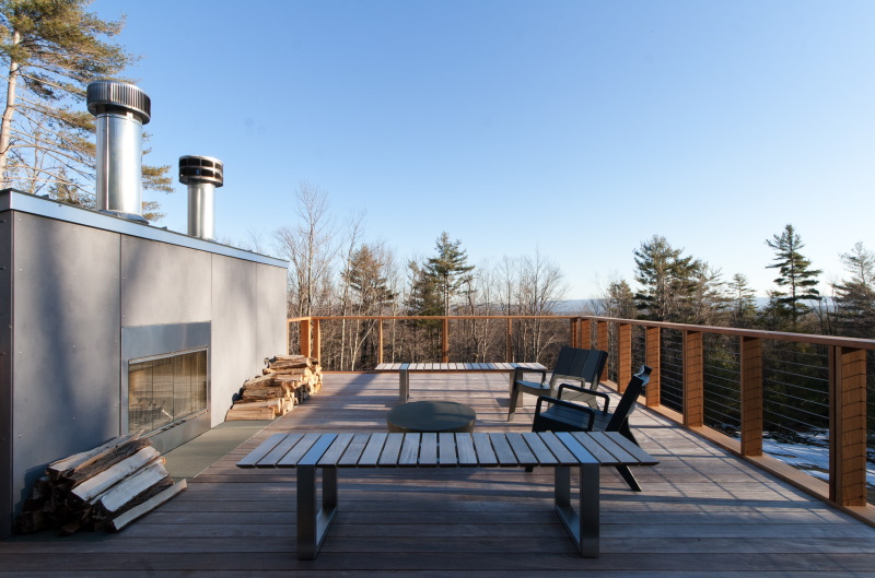 Roof deck with outdoor furniture and firewood