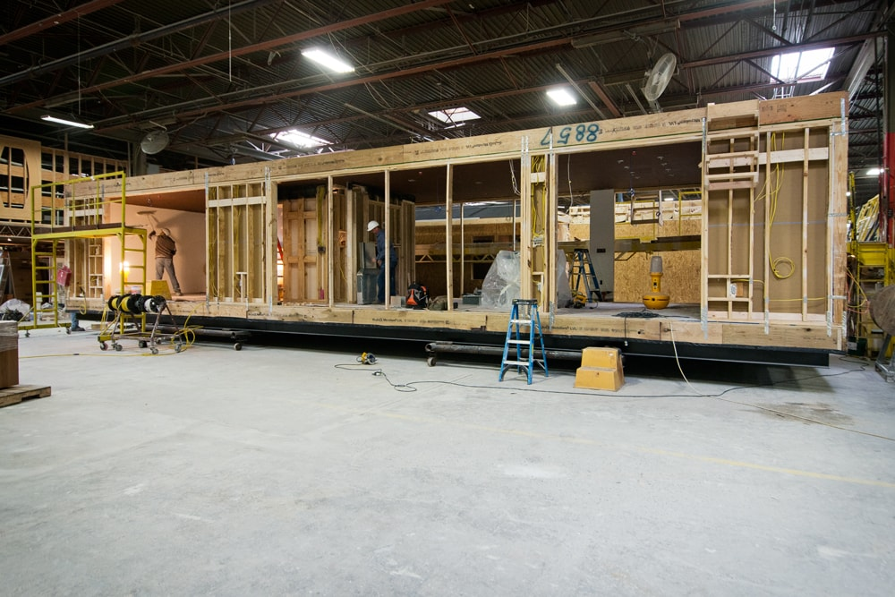 Module in factory with sheetrock being applied to the interior