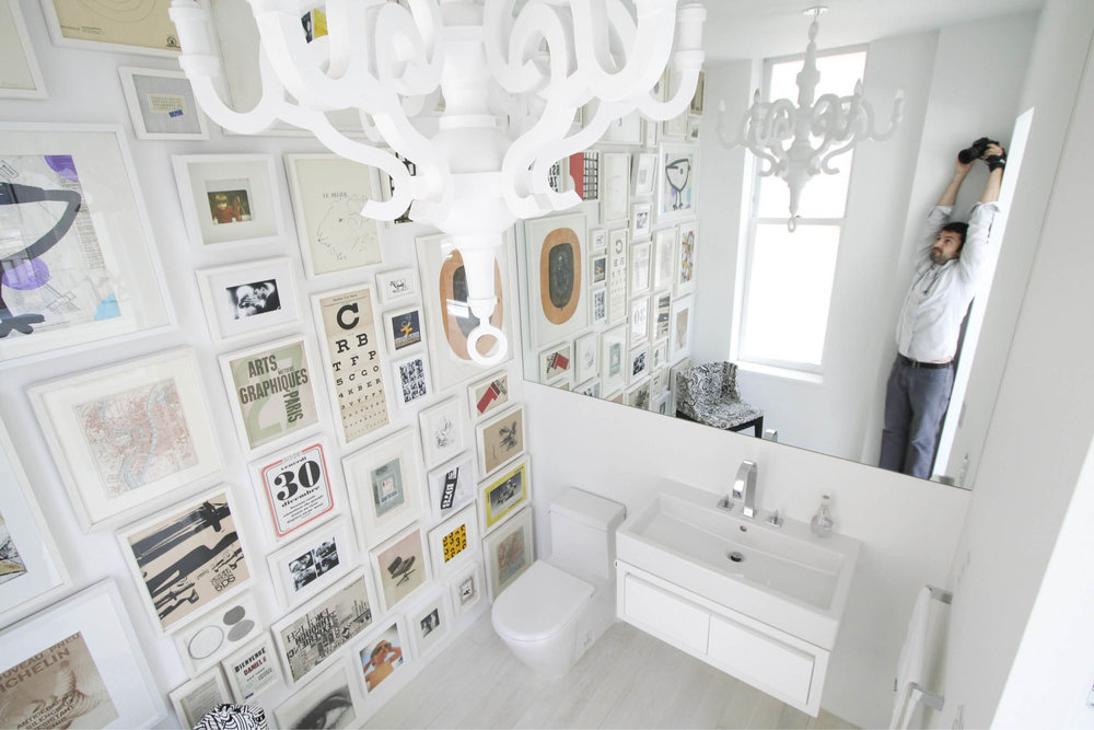 Modern New York City Union Square Loft Renovation | White Powder Room Bathroom with Art | RES4