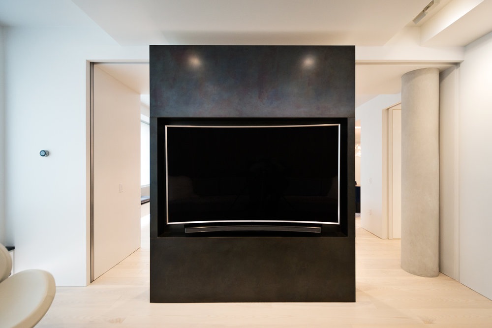 Modern New York City Lenox Hill Apartment Renovation | Black Steel TV Media Wall Pocket Doors | RES4