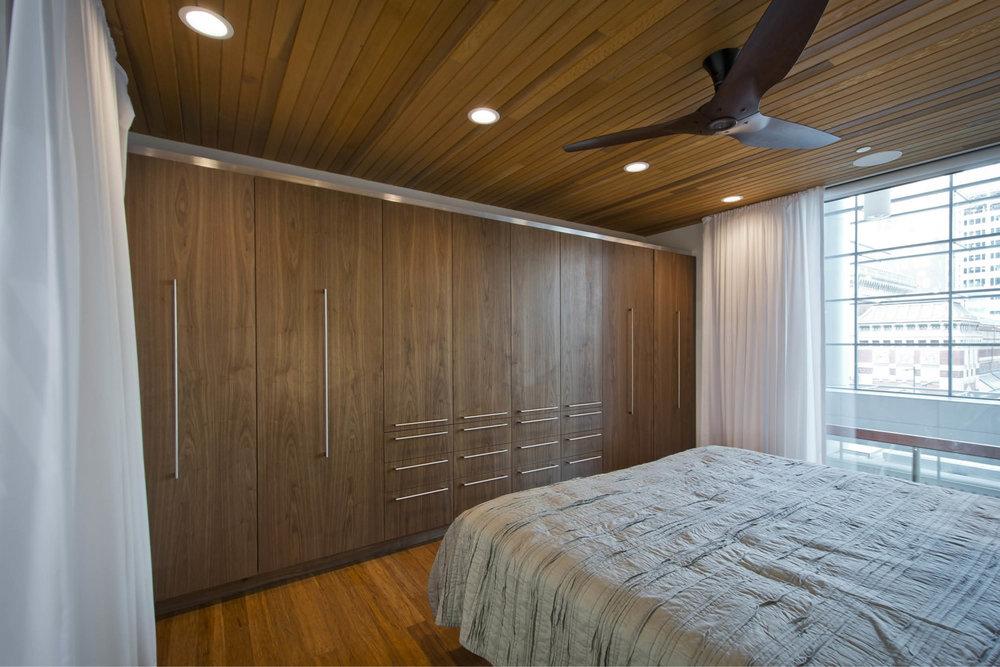 Modern Modular Prefab Cabin House | Greenbuild | Philadelphia | Bedroom Cedar Ceiling Built In Bed Cabinetry Sliding Doors | RES4