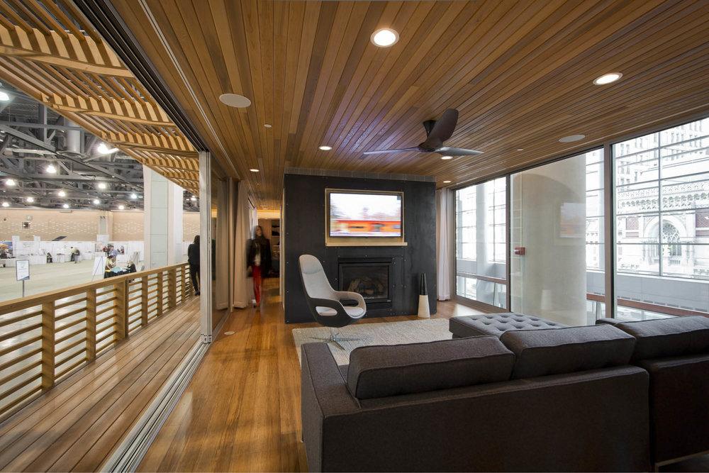Modern Modular Prefab Cabin House | Greenbuild | Philadelphia | Living Room Cedar Ceiling Fireplace Black Steel Railing Deck Sliding Doors | RES4