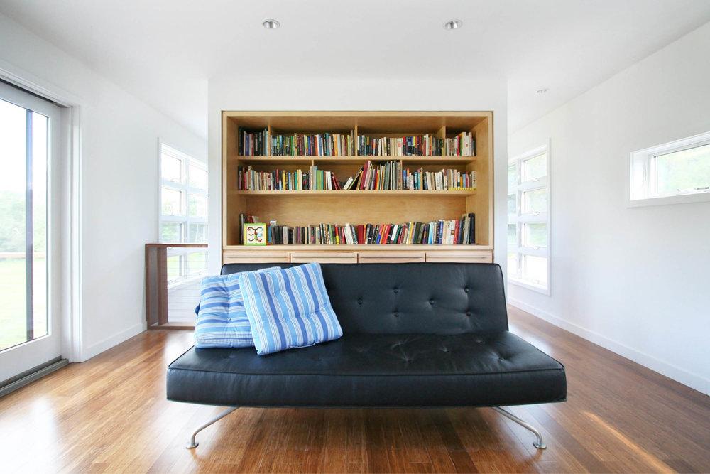 Modern Modular Prefab Meadow House | New York State | Living Room Custom Built In Cabinets Sliding Doors White | RES4