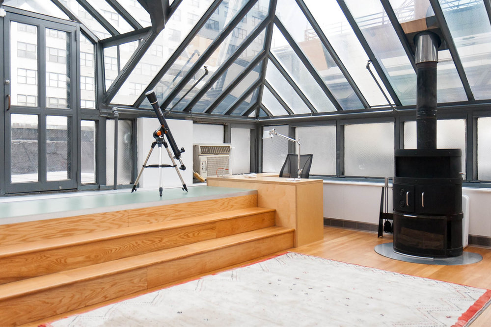 Loft Apartment Renovation | Union Square New York City 14th Street | Living Room Skylight Glass Roof Wood Steps Fireplace | RES4